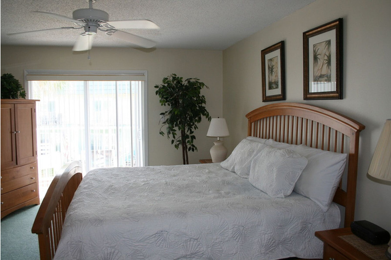 Master bedroom with white colored bedding
