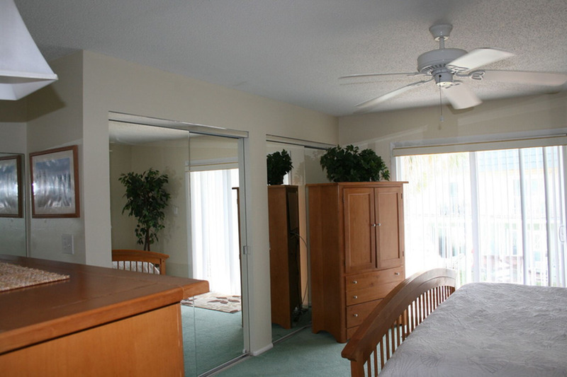 Master bedroom with dresser and cabinets